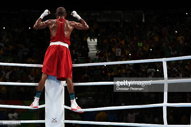 Robson Conceicao of Brazil celebrates after winning gold against Sofiane Oumiha of France in the Men's Light event on Day 11 of the Rio 2016 Olympic...