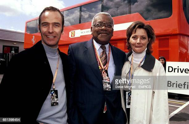 Robson Green Trevor McDonald and Carol Vorderman enjoy the race day atmosphere of the paddock