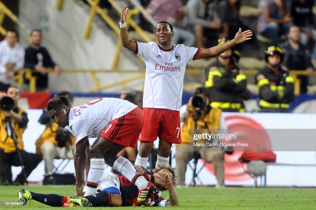 Robson Robinho # 7 of AC Milan reacts as his teamate <a gi-track='captionPersonalityLinkClicked' href=/galleries/search?phrase=Kevin+Constant&family=editorial&specificpeople=3033289 ng-click='$event.stopPropagation()'>Kevin Constant</a> # 21 of AC Milan looks on during the Serie A match between Bologna and AC Milan at Stadio Renato Dall'Ara on September 25, 2013 in Bologna, Italy.