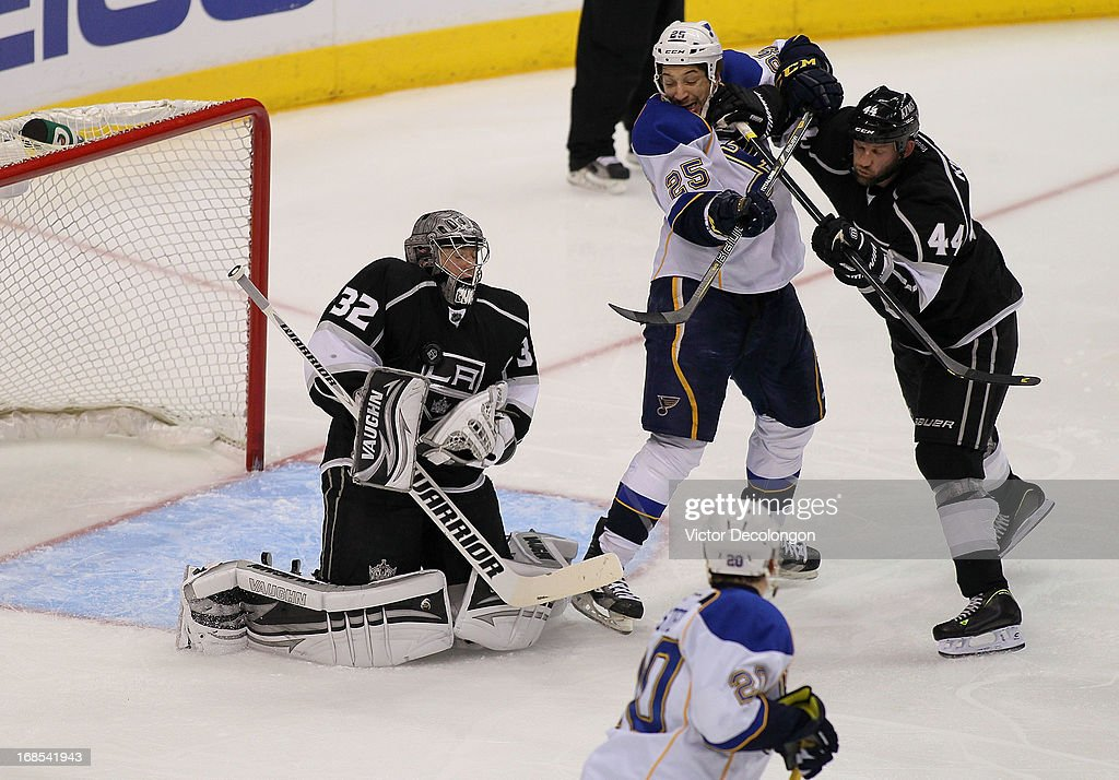 Roby Regehr #44 of the Los Angeles Kings checks Chris Stewart #25 of the St. Louis Blues as goaltender Jonathan Quick #32 of the Los Angeles Kings makes a save in the second period of Game Six of the Western Conference Quarterfinals during the 2013 NHL Stanley Cup Playoffs at Staples Center on May 10, 2013 in Los Angeles, California. The Kings defeated the Blues 2-1 to win the series 4 games to 2 to advance to the Western Conference Semifinal.