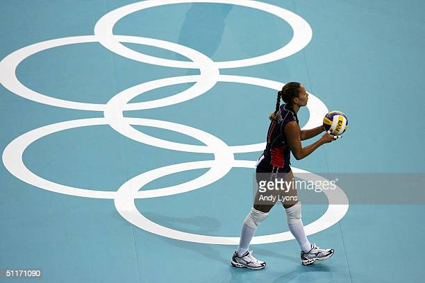 Robyn Ah Mow Santos of the United States prepares to serve against China in the women's indoor Volleyball preliminary match on August 14 2004 during...