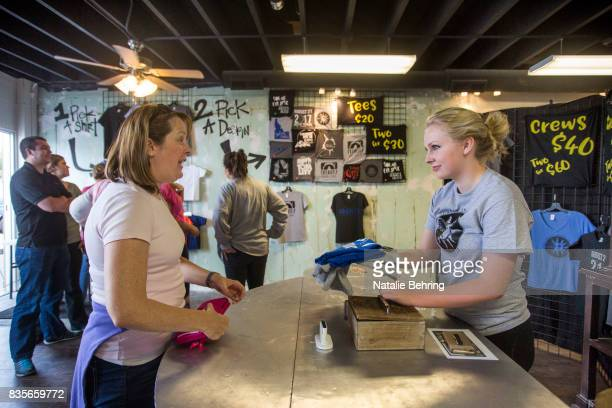 Robyn AtkinsonDunn a tourist from Salt Lake City stops at a popup tshirt shop to buy an eclipse themed tshirt on August 19 2017 in Rexburg Idaho...
