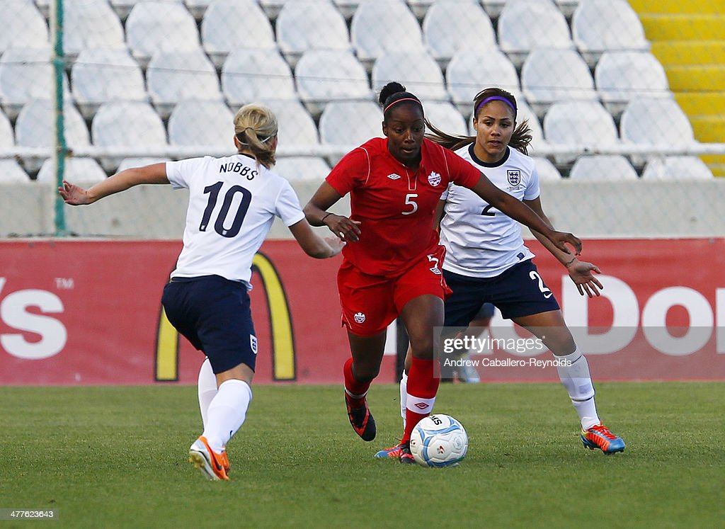Robyn Gayle (C) of Canada in action during the Cyprus Cup match between England and Canada at GSP stadium on March 10, 2014 in Nicosia, Cyprus.