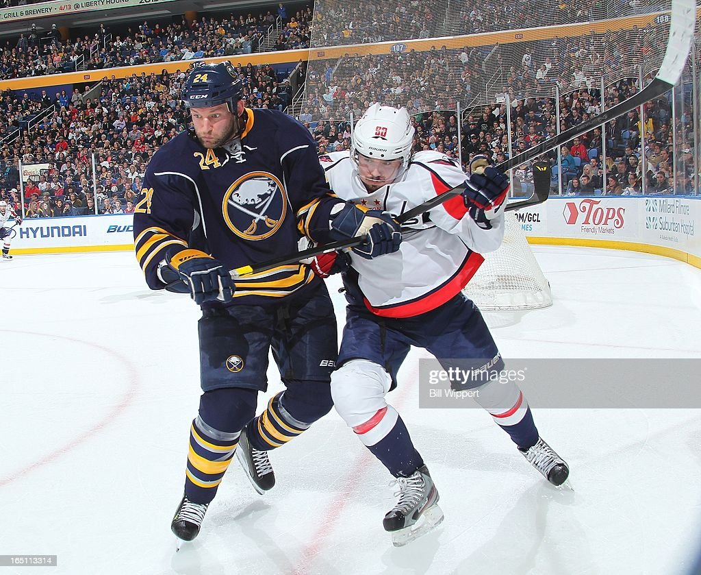 <a gi-track='captionPersonalityLinkClicked' href=/galleries/search?phrase=Robyn+Regehr&family=editorial&specificpeople=171828 ng-click='$event.stopPropagation()'>Robyn Regehr</a> #24 of the Buffalo Sabres defends against <a gi-track='captionPersonalityLinkClicked' href=/galleries/search?phrase=Marcus+Johansson&family=editorial&specificpeople=4247883 ng-click='$event.stopPropagation()'>Marcus Johansson</a> #90 of the Washington Capitals on March 30, 2013 at the First Niagara Center in Buffalo, New York.