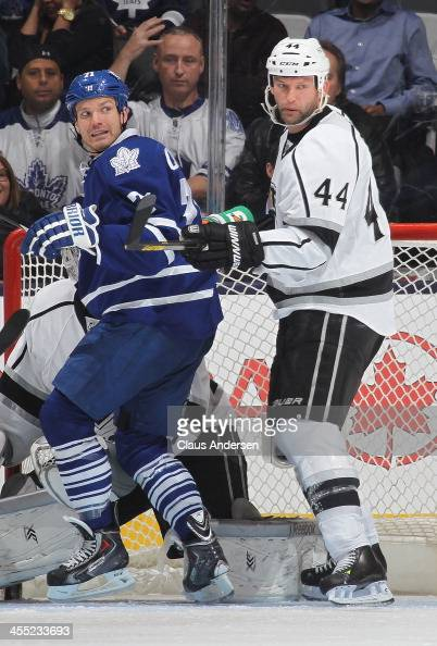 Robyn Regehr of the Los Angeles Kings defends against David Clarkson of the Toronto Maple Leafs during an NHL game at the Air Canada Centre on...
