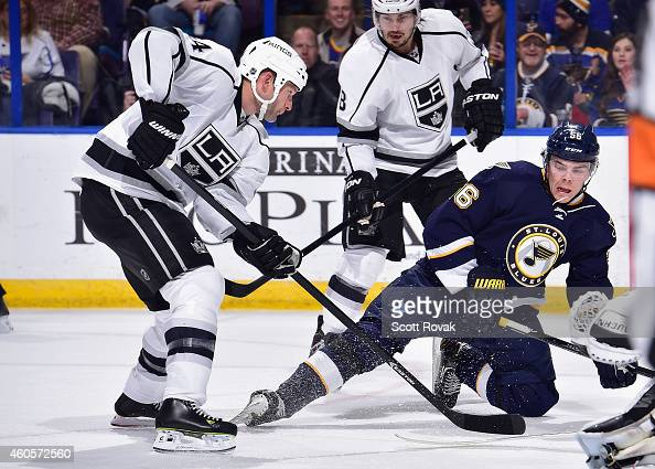 Robyn Regehr of the Los Angeles Kings defends against Magnus Paajarvi of the St Louis Blues at the Scottrade Center on December 16 2014 in St Louis...
