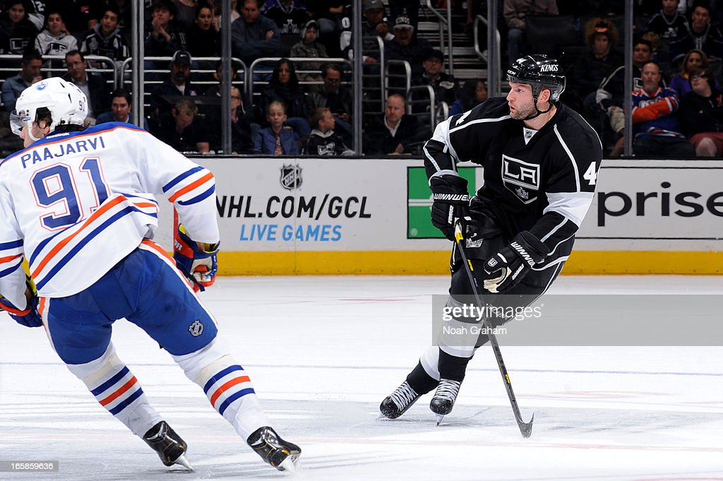 <a gi-track='captionPersonalityLinkClicked' href=/galleries/search?phrase=Robyn+Regehr&family=editorial&specificpeople=171828 ng-click='$event.stopPropagation()'>Robyn Regehr</a> #44 of the Los Angeles Kings looks for the puck against the Edmonton Oilers at Staples Center on April 6, 2013 in Los Angeles, California.