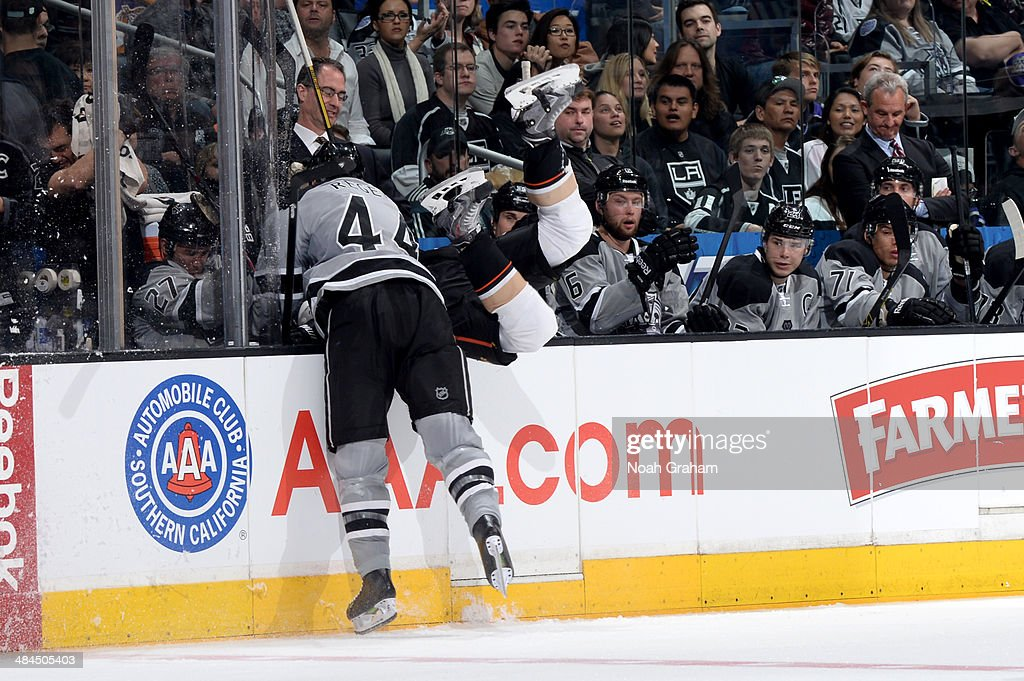 <a gi-track='captionPersonalityLinkClicked' href=/galleries/search?phrase=Robyn+Regehr&family=editorial&specificpeople=171828 ng-click='$event.stopPropagation()'>Robyn Regehr</a> #44 of the Los Angeles Kings throws the check against the Anaheim Ducks at Staples Center on April 12, 2014 in Los Angeles, California.