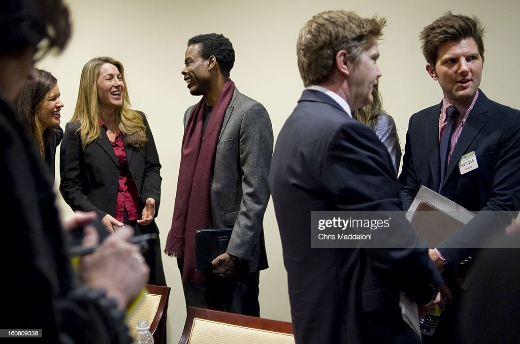 Robyn Thomas, Executive Director, Law Center to Prevent Gun Violence; comedian Chris Rock; and actor Adam Scott prepare to speak at a press conference at the U.S. Capitol to call on Congress to act on President Obama's plan to reduce gun violence, including background checks for all gun sales and an assault weapons ban.