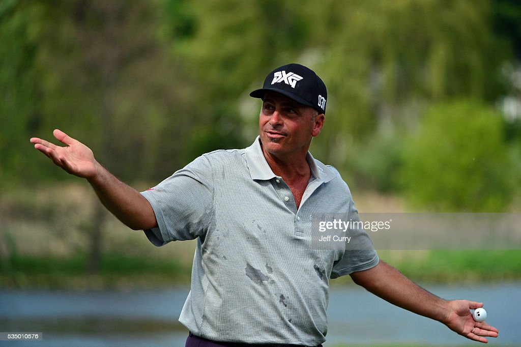 <a gi-track='captionPersonalityLinkClicked' href=/galleries/search?phrase=Rocco+Mediate&family=editorial&specificpeople=220352 ng-click='$event.stopPropagation()'>Rocco Mediate</a> gestures to the crowd as he walks off the 18th green after finishing the third round of the 2016 Senior PGA Championship presented by KitchenAid at the Golf Club at Harbor Shores on May 28, 2016 in Benton Harbor, Michigan.