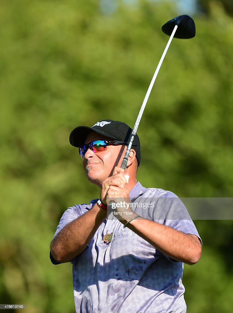 Rocco Mediate hits a tee shot on the 11th hole during round one of the U.S. Senior Open Championship at the Del Paso Country Club on June 25, 2015 in Sacramento, California.