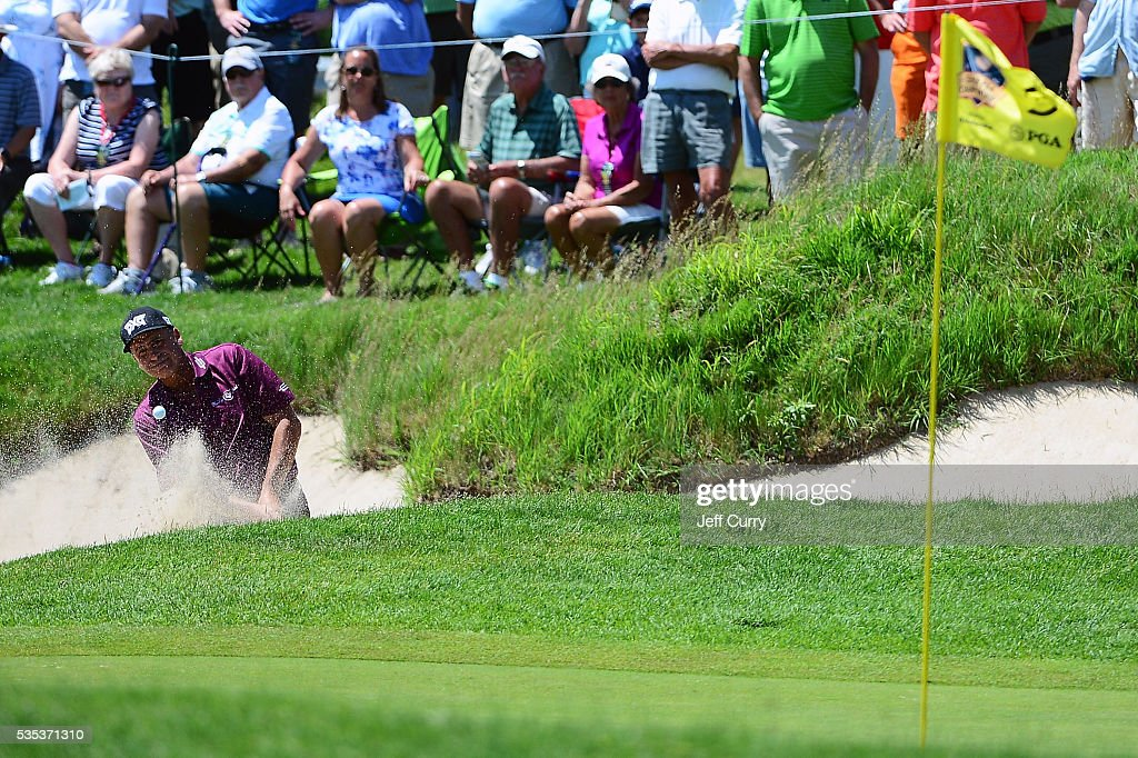 <a gi-track='captionPersonalityLinkClicked' href=/galleries/search?phrase=Rocco+Mediate&family=editorial&specificpeople=220352 ng-click='$event.stopPropagation()'>Rocco Mediate</a> hits from the bunker on the fifth hole during the final round of the 2016 Senior PGA Championship presented by KitchenAid at the Golf Club at Harbor Shores on May 29, 2016 in Benton Harbor, Michigan.