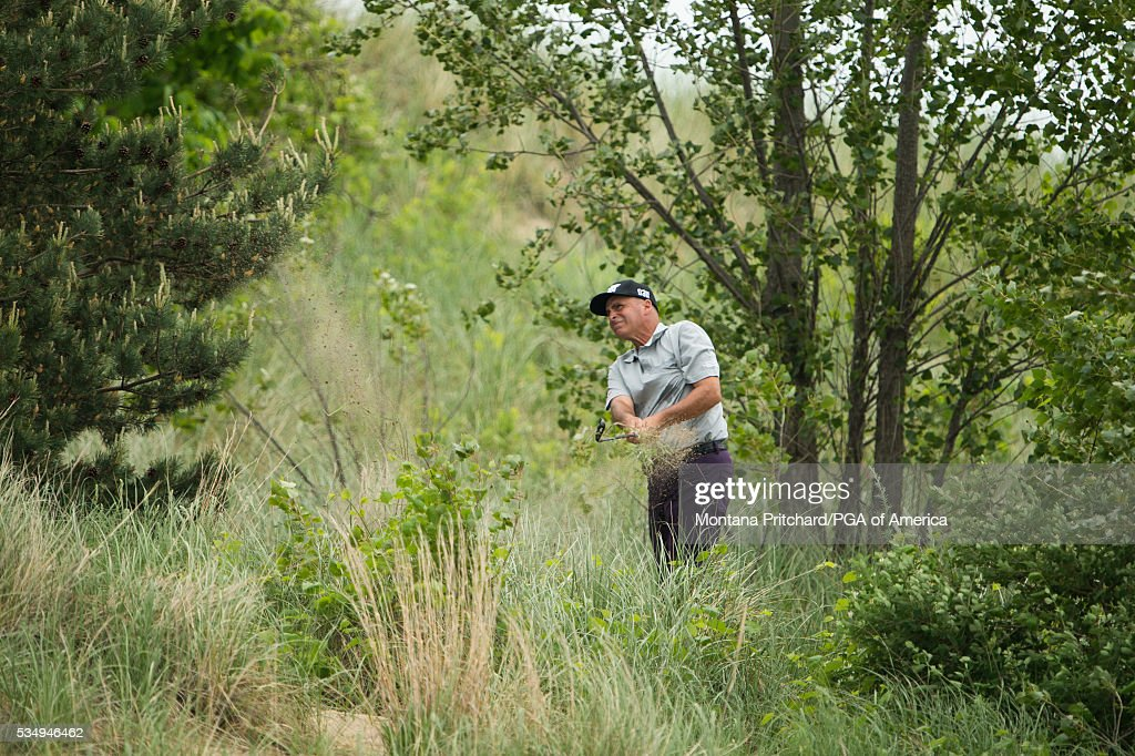 <a gi-track='captionPersonalityLinkClicked' href=/galleries/search?phrase=Rocco+Mediate&family=editorial&specificpeople=220352 ng-click='$event.stopPropagation()'>Rocco Mediate</a> hits out of the rough on the eighth hole during the third round for the 77th Senior PGA Championship presented by KitchenAid held at Harbor Shores Golf Club on May 28, 2016 in Benton Harbor, Michigan.