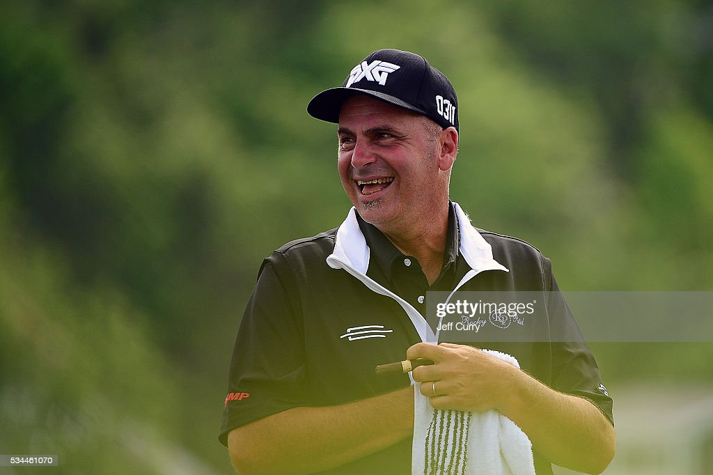 <a gi-track='captionPersonalityLinkClicked' href=/galleries/search?phrase=Rocco+Mediate&family=editorial&specificpeople=220352 ng-click='$event.stopPropagation()'>Rocco Mediate</a> jokes around with fans as he waits to tee off on the eighth hole during the first round 2016 Senior PGA Championship presented by KitchenAid at the Golf Club at Harbor Shores on May 26, 2016 in Benton Harbor, Michigan.
