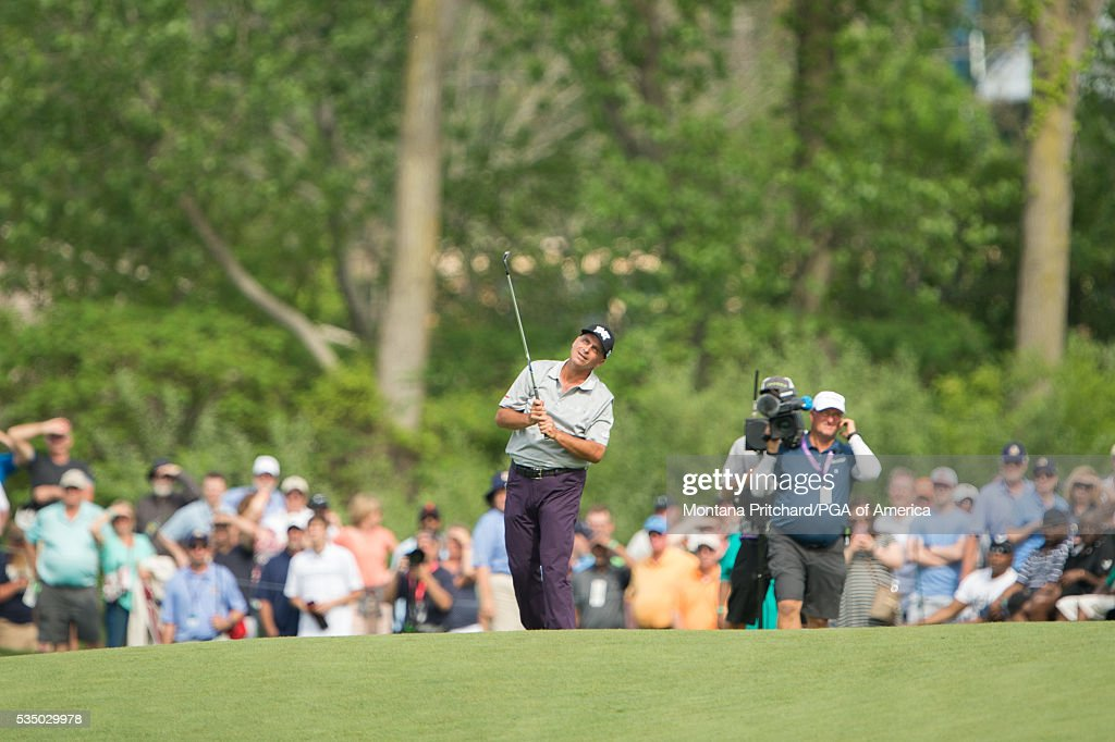 <a gi-track='captionPersonalityLinkClicked' href=/galleries/search?phrase=Rocco+Mediate&family=editorial&specificpeople=220352 ng-click='$event.stopPropagation()'>Rocco Mediate</a> of the United States makes his second shot on the 18th hole during the third round for the 77th Senior PGA Championship presented by KitchenAid held at Harbor Shores Golf Club on May 28, 2016 in Benton Harbor, Michigan.