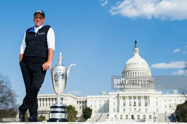 Rocco Mediate poses for a portrait with the Alfred S Bourne Trophy outside of the US Capitol during the 78th KitchenAid Senior PGA Championship Media...