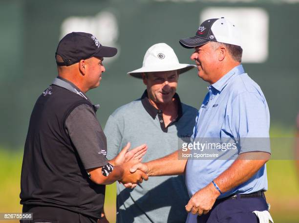 Rocco Mediate shakes hands with Kenny Perry after they finished their round during the First Round of the 3M Championship at TPC Twin Cities on...
