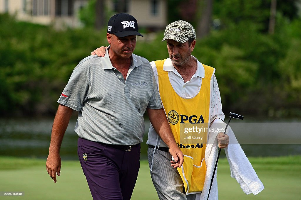<a gi-track='captionPersonalityLinkClicked' href=/galleries/search?phrase=Rocco+Mediate&family=editorial&specificpeople=220352 ng-click='$event.stopPropagation()'>Rocco Mediate</a> walks off the 18th green with his caddy after finishing the third round of the 2016 Senior PGA Championship presented by KitchenAid at the Golf Club at Harbor Shores on May 28, 2016 in Benton Harbor, Michigan.