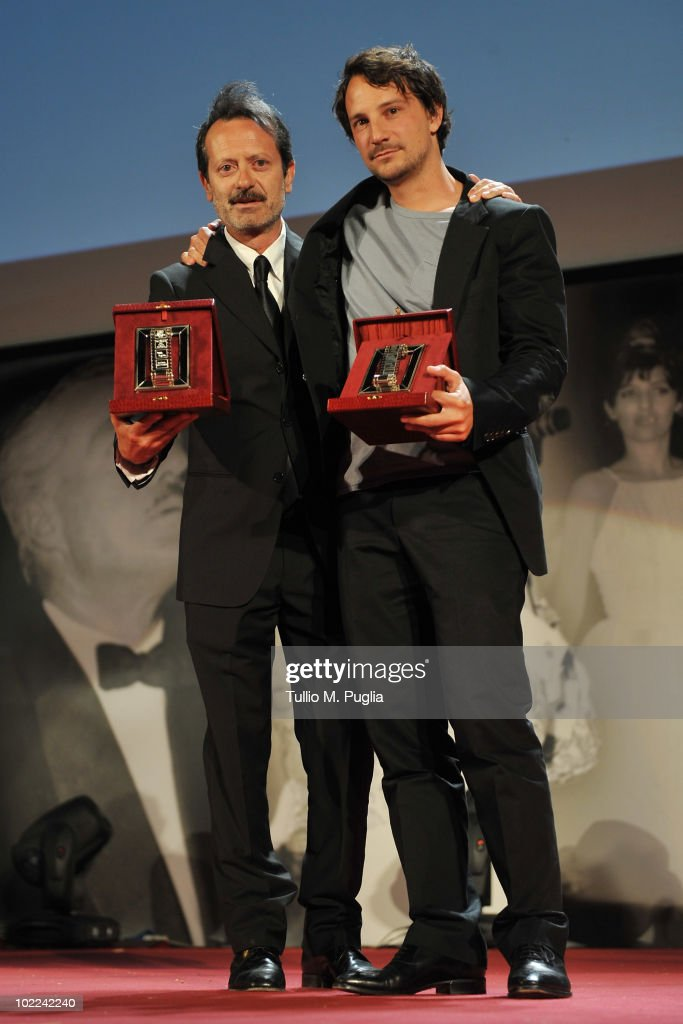 Rocco Papaleo (L) and Valerio Mieli pose with the award for Best Newcomer Director (Ex Aequo) during the Nastri d'Argento ceremony awards on June 19, 2010 in Taormina, Italy.