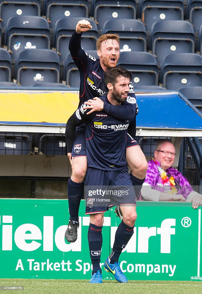 Rocco Quinn celebrates his goal for Ross County with Craig Curran (top) during the Scottish premiership match between Kilmarnock and Ross County at Rugby Park on May 23, 2015 in Kilmarnock, Scotland.