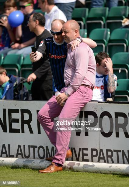 A Rochdale fan has a 'Selfie' taken with manager Keith Hill before the Sky Bet League Two match at Rodney Parade Newport