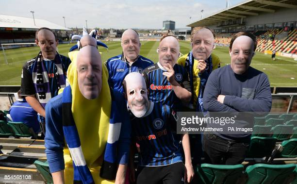 Rochdale fans wearing face masks of manager Keith Hill [inside the stadium before the Sky Bet League Two match at Rodney Parade Newport