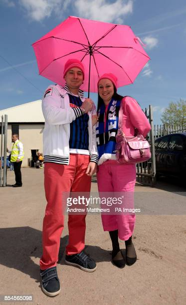 Rochdale fans wearing pink in honour of manager Keith Hill outside the ground before the Sky Bet League Two match at Rodney Parade Newport