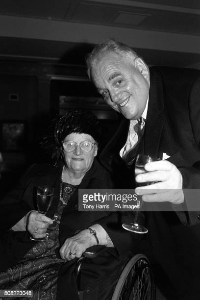 Rochdale MP Cyril Smith and his mother Eva drink a champagne toast at their London hotel this morning before setting off for Buckingham Palace to...