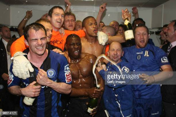 Rochdale players celebrate after gaining promotion the club's first promotion in 41 years at the end of the Coca Cola League Two Match between...