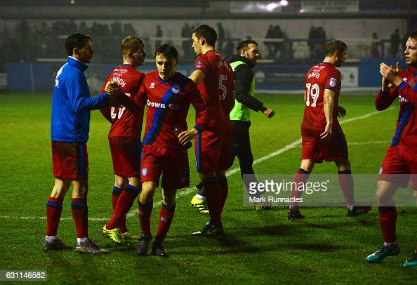 Rochdale players celebrate at the final whistle after beating Barrow AFC 20 during the Emirates FA Cup third round match between Barrow AFC and...