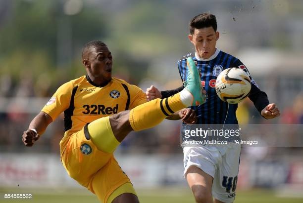 Rochdale's Ian Henderson and Newport County's Ryan Jackson battle for the ball during the Sky Bet League Two match at Rodney Parade Newport
