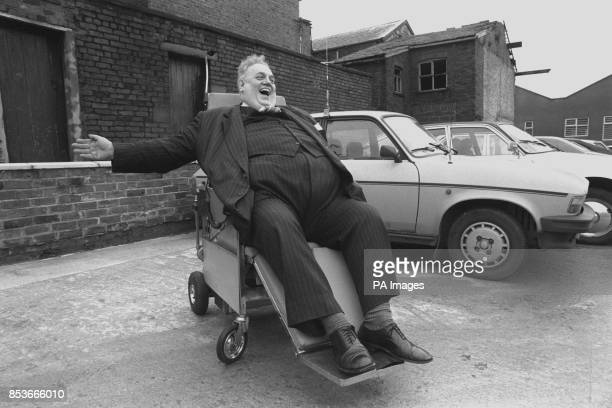Rochdale's Liberal MP Cyril Smith signals a right turn while testing a motorised wheelchair which converts to a stretcher at AshtonunderLyne The...
