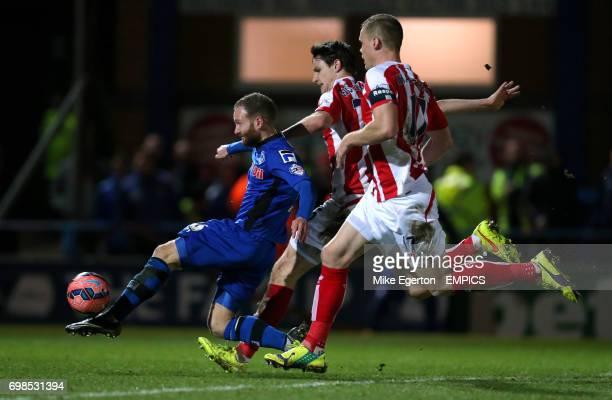 Rochdale's Matthew Done gets a shot in on goal from Stoke's Phillip Wollscheid and Ryan Shawcross