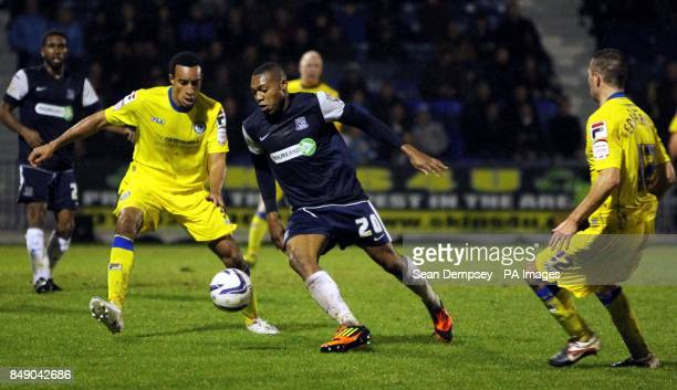 Rochdale's Rhys Bennett and Southends Britt Assombalonga battle for the ball during the npower Football League Two match at Roots Hall Southend On Sea