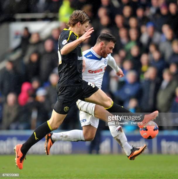 Rochdale's Scott Hogan and Sheffield wednesday's Glenn Loovens battle for the ball
