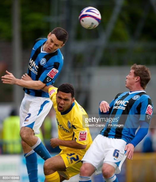 Rochdale's Simon Ramsden heads away from Gillingham's Andy Barcham during the CocaCola League Two Play Off Semi Final First Leg match at Spotland...