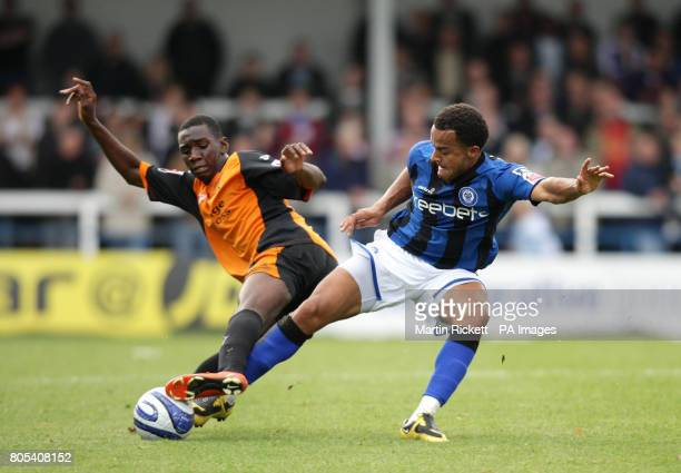 Rochdales Simon Whaley battles with Barnet's Yannick Bolasie during the CocaCola League Two match at the Spotland Stadium Rochdale
