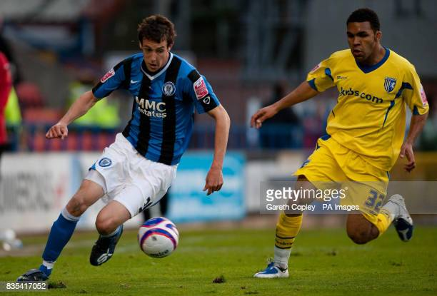 Rochdale's Will Buckley gets past Gillingham's Andy Barcham during the CocaCola League Two Play Off Semi Final First Leg match at Spotland Stadium...