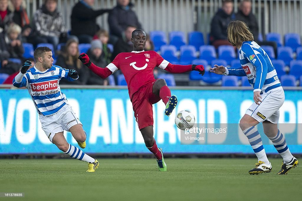 Rochdi Achenteh of PEC Zwolle, Edwin Gyasi of FC Twente, Joost Broerse of PEC Zwolle during the Dutch Eredivisie match between PEC Zwolle and FC Twente at the IJsseldelta Stadium on february 10, 2013 in Zwolle, The Netherlands