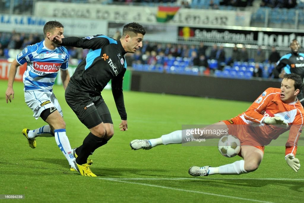 Rochdi Achenteh of PEC Zwolle, Ninos Gouriye of Heracles Almelo, goalkeeper Diederik Boer of PEC Zwolle during the Dutch Cup match between PEC Zwolle and Heracles Almelo at the IJsseldelta Stadium on january 30, 2013 in Zwolle, The Netherlands
