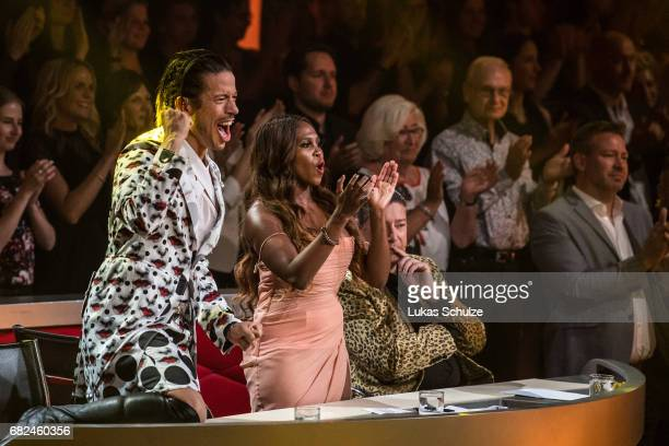 Roche Gonzales Motsi Mabuse and Joachim Llambi react on stage during the 8th show of the tenth season of the television competition 'Let's Dance' on...