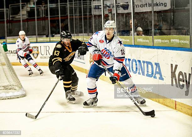 Rochester Americans center Mike Aviani skates away from Providence Bruins defenseman Matt Bartkowski during an AHL Hockey game between the Providence...