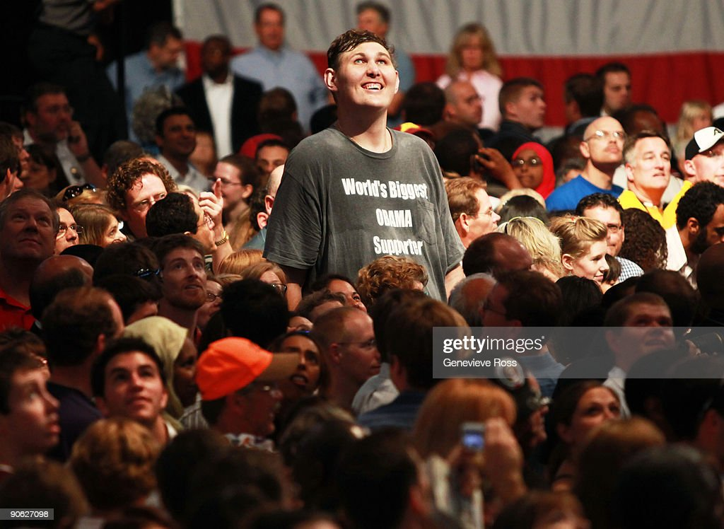 Rochester, Minnesota resident Igor Vovkovinskiy, 27, watches as President Barack Obama arrives to speak on health care during a rally at the Target Center on September 12, 2009 in Minneapolis, Minnesota. The President is trying to gain support for his health insurance reform plans.