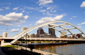 Rochester New York Skyline With The Genesee River And The Susan B Anthony And Fredrick Douglas Bridge