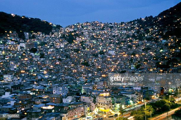 Rocinha Latin America's largest urban favela and one of Rio's 700 with a pop of approx 200000 residents Its currently in the middle of a drug 'war'...