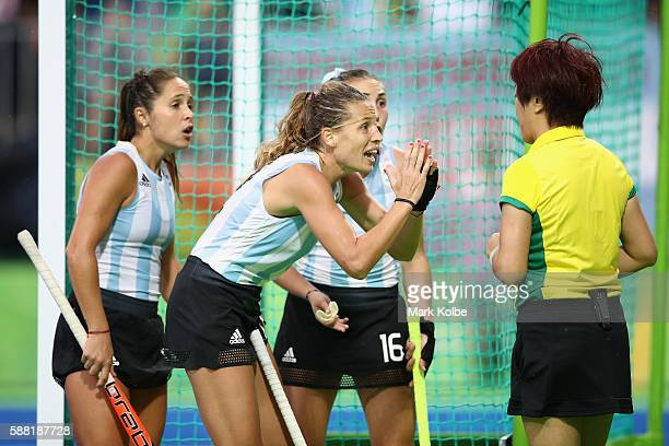 Rocio Sanchez Delfina Merino and Florencia Habif of Argentina make their point to the umpire during the women's pool B match between Great Britain...