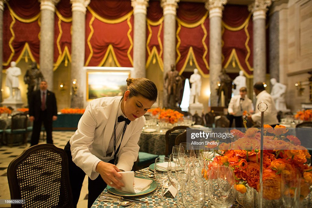 Rocio Saucedo of Design Cuisine folds napkins in preparation for the Inaugural Luncheon in Statuary Hall on Inauguration day at the U.S. Capitol building January 21, 2013 in Washington D.C. U.S. President Barack Obama will be ceremonially sworn in for his second term today.