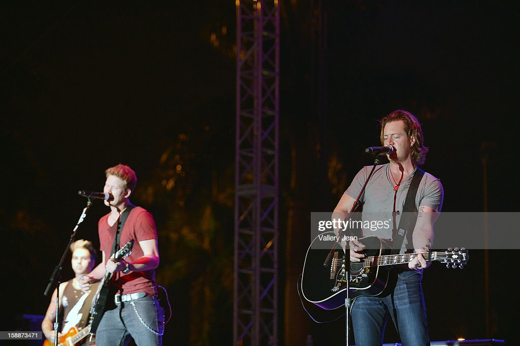 Rock and Country singer Brian Kelley and Tyler Hubbard of Florida Georgia Line perform at the Bud Light Orange Bowl Fan Zone during the 2013 Discover Orange Bowl at Sunlife Stadium on January 1, 2013 in Miami, Florida.