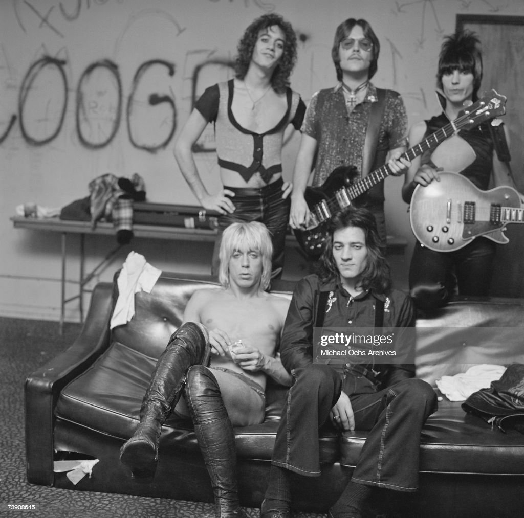 Rock and roll band 'Iggy and The Stooges' pose for a portrait backstage at the Whisky A-Go-Go on October 30, 1973 in West Hollywood, California. 8901 Sunset Boulevard, Front row L-R: Iggy Pop (born James Osterberg, Jr.), Scott Asheton, Back row L-R:Scott Thurston, Ron Asheton, James Williamson backstage.