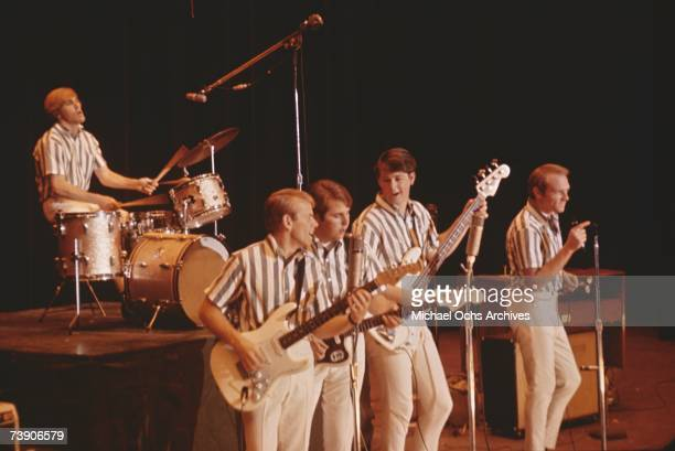 Rock and roll band 'The Beach Boys' perform onstage in circa 1964 in California Dennis Wilson Al Jardine Carl Wilson Brian Wilson Mike Love